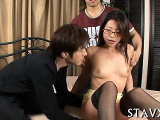 Lusty asian playgirl strokes on her hirsute beaver naughtily