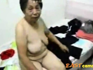 Asian Grandma win dressed after sex